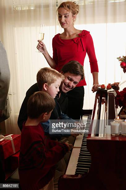 Family playing piano together