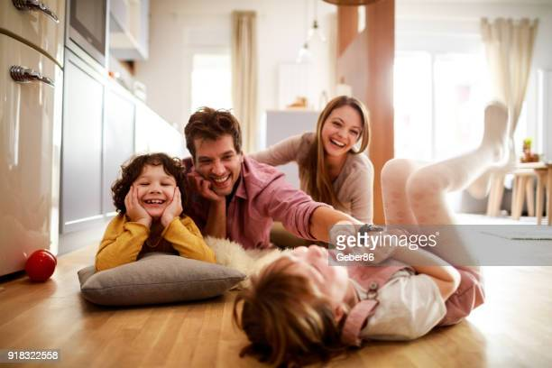 family playing - at home stock pictures, royalty-free photos & images