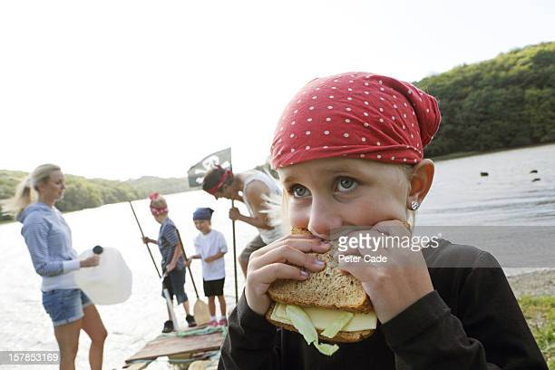 family playing pirates by water with picnic - cornish flag stock pictures, royalty-free photos & images