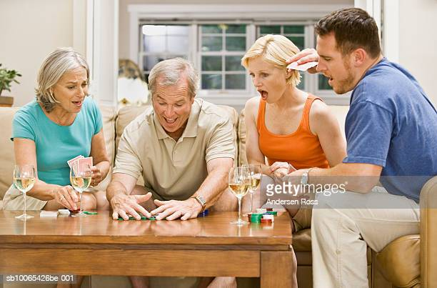 Family playing Poker and drinking wine