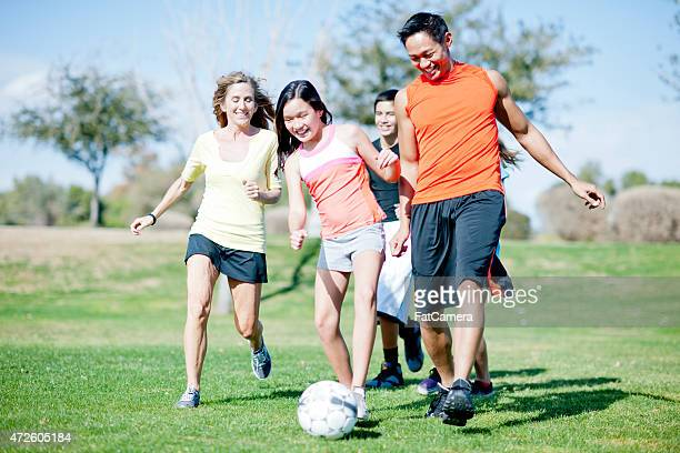 Family Playing Soccer at the Park
