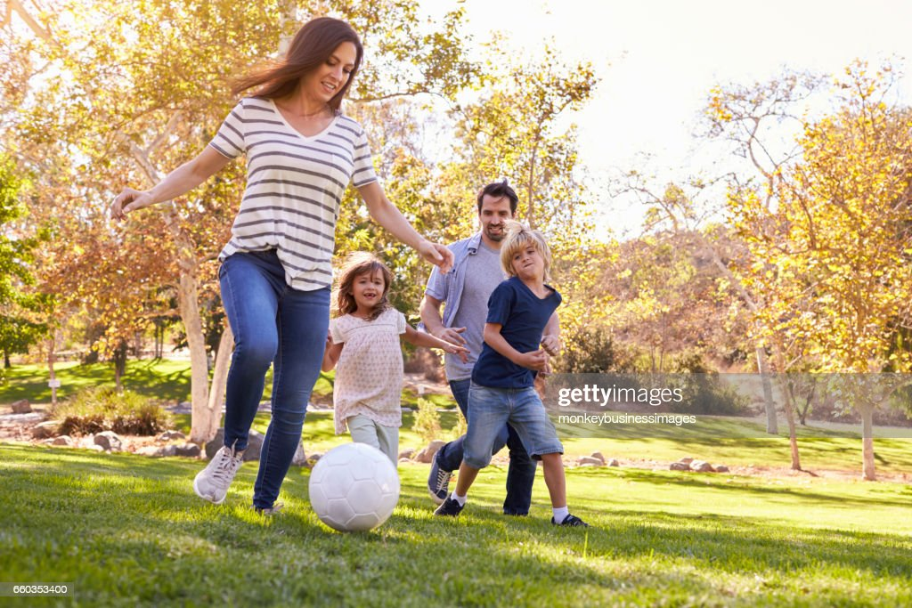Family Playing Soccer In Park Together : Stock Photo