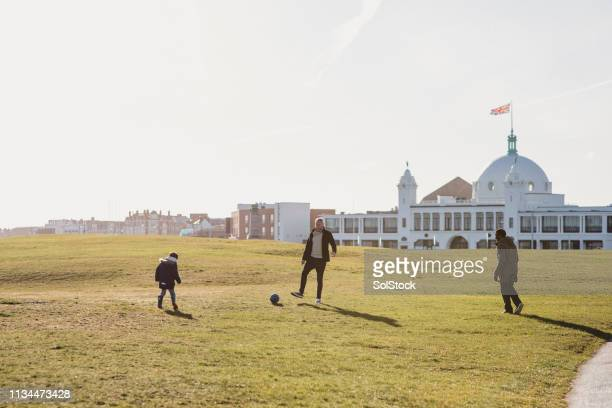 family playing soccer - wide shot stock pictures, royalty-free photos & images