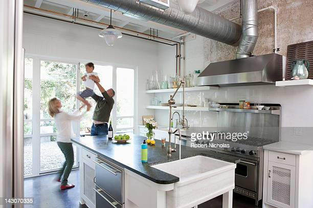 Family playing together in kitchen