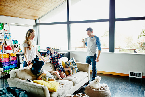 Family playing together in living room of home - gettyimageskorea