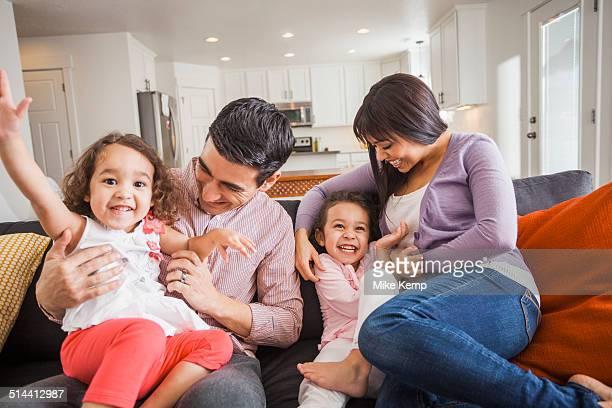 family playing together on sofa - domestic life imagens e fotografias de stock