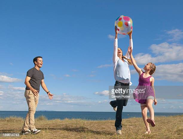 family playing together outdoors - catching stock pictures, royalty-free photos & images