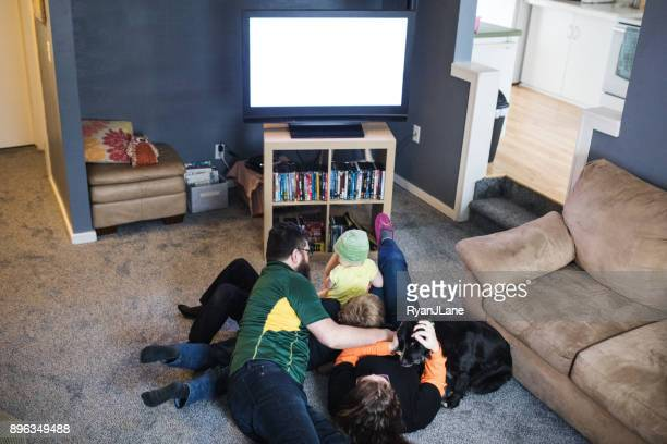 family playing while watching football game - naughty america member stock photos and pictures