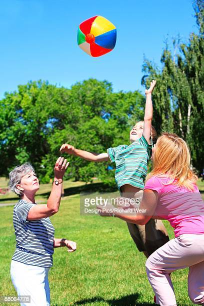 family playing with a ball - blue balls pics stock pictures, royalty-free photos & images
