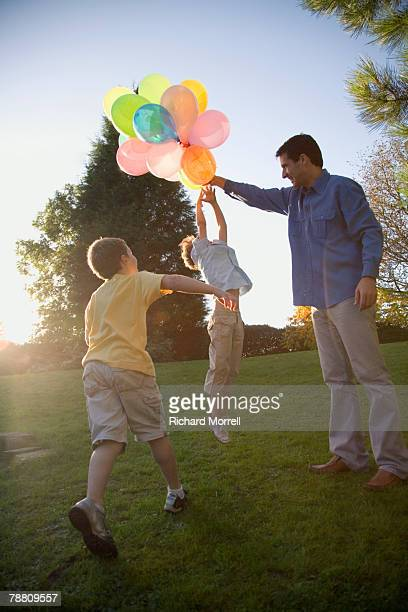 Family Playing with Balloon