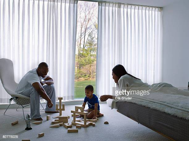 family playing with blocks in the morning