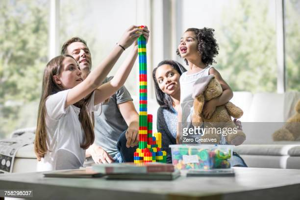 Family playing with building blocks