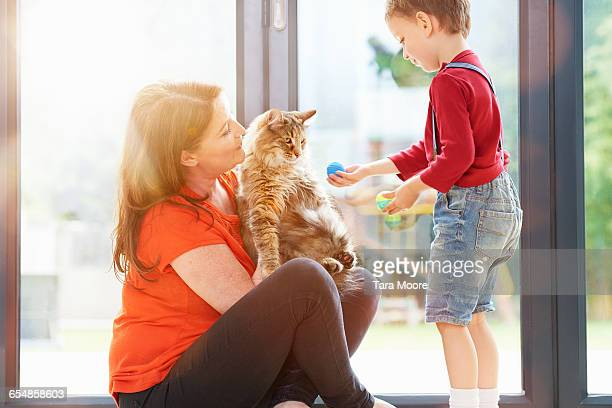 family playing with cat
