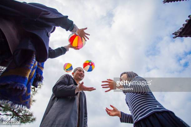 Family playing with paper balloon