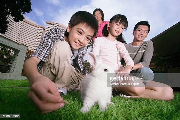 Family Playing with Pet Rabbit