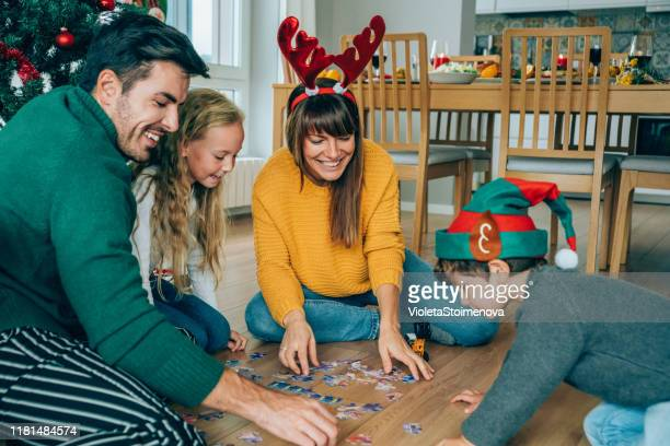 family playing with the new christmas gifts - leisure games stock pictures, royalty-free photos & images