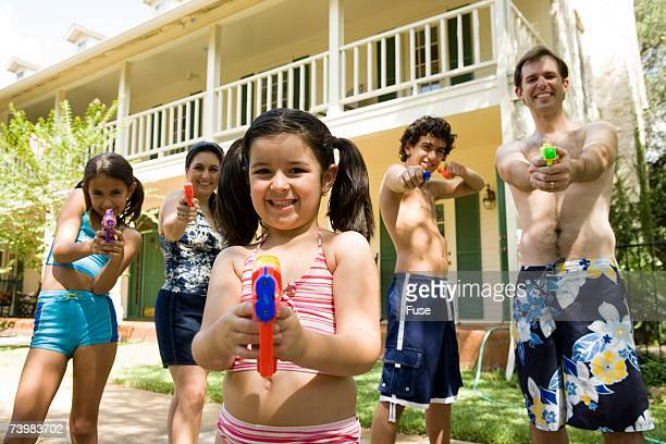 Family playing with water guns