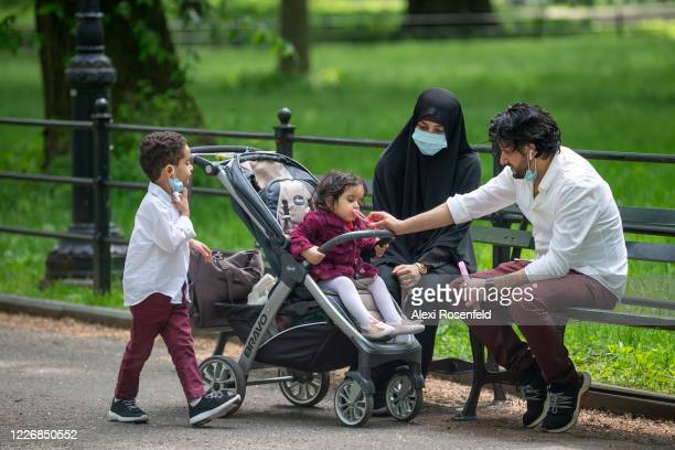A family plays together in Central Park on May 24 2020 in New York City Government guidelines encourage wearing a mask in public with strong social...