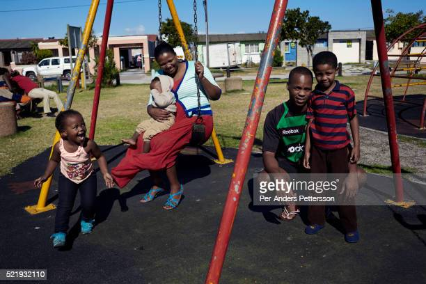 A family plays with their children at a playground in Guguletu a township about ten miles outside Cape Town South Africa