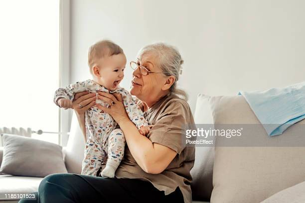 family playtime - grandmother stock pictures, royalty-free photos & images