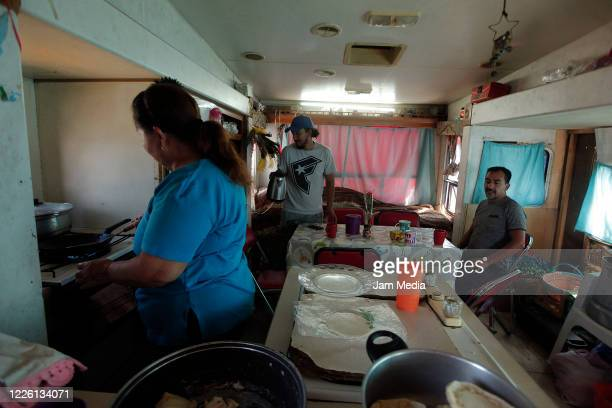 Family Ponce eating inside of circus trailer on May 20 2020 in Queretaro Mexico As nonessential activities are not permitted during stage three of...