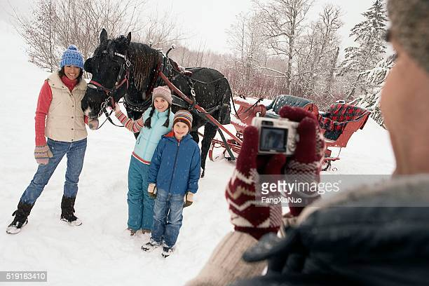 Family portrait by horse drawn sleigh