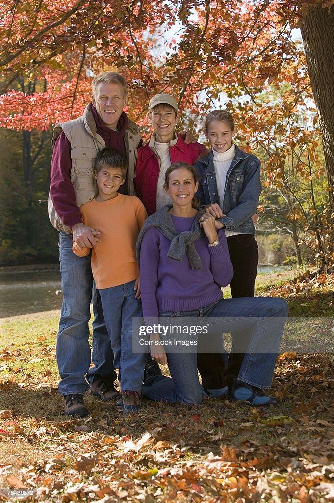 Family portrait in fall foliage : Stock Photo