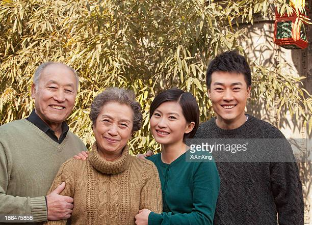 Family Portrait in front of Bamboo