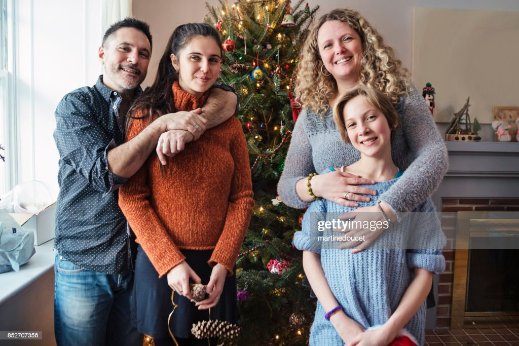 Family portrait in front of Christmas tree at home. : Stock Photo