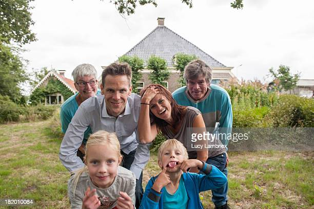 Family portrait in front of farm home