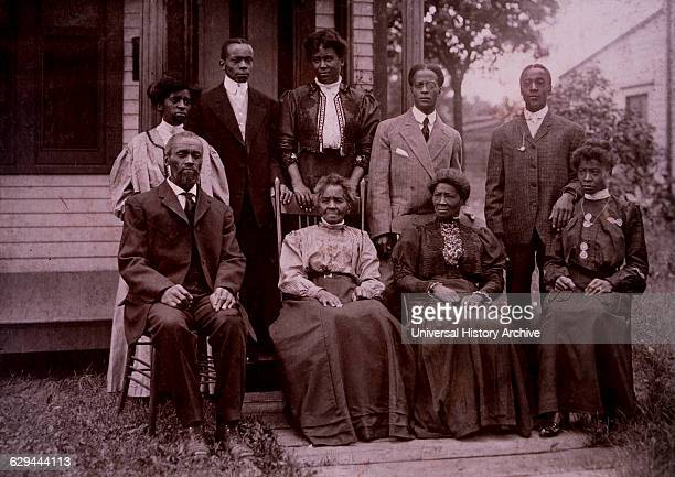 Family Portrait in Front of House, Milwaukee, Wisconsin, USA, 1910.