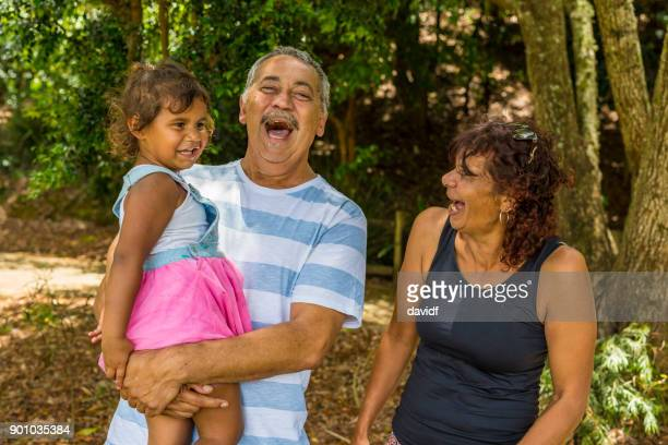 Family Portrait of an Australian Aboriginal Couple with Their Grandaughter