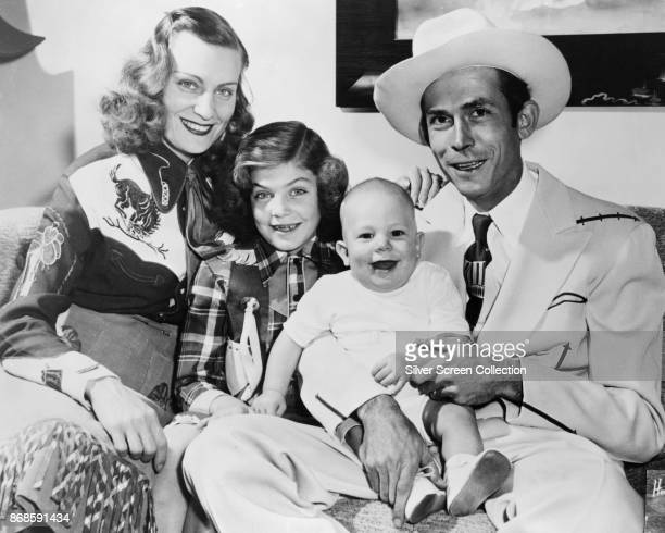 Family portrait of married American country musicians Audrey Williams and Hank Williams Sr as they pose with their children Lycrecia and Hank...