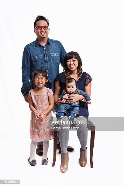 family portrait of mid adult couple with daughter and baby boy - mom sits on sons lap stock pictures, royalty-free photos & images