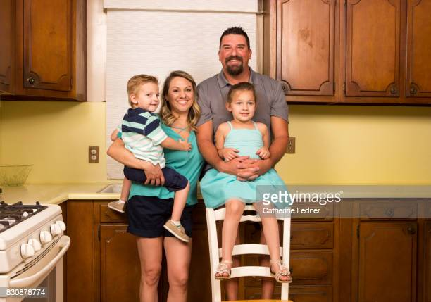 family portrait of middle america family posing in grandmother's empty kitchen - monrovia california stock pictures, royalty-free photos & images