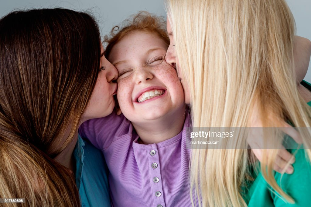 Family portrait of mother and daughters close-up. : Stock Photo