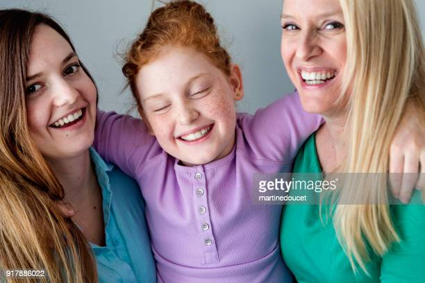 """family portrait of mother and daughters close-up. - """"martine doucet"""" or martinedoucet stock pictures, royalty-free photos & images"""