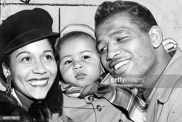 A family portrait of the boxing champion Sugar Ray Robinson with his wife Edna Mae Robinson nee Holly and their son Ray Robinson Jr July 7 1951