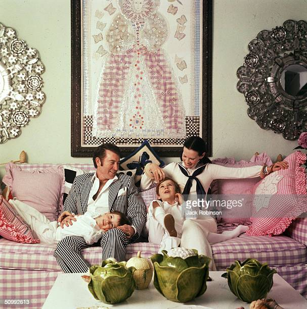 Family portrait of the Coopers as they play on a sofa in their home Southampton Long Island New York March 30 1972 American author and actor Wyatt...