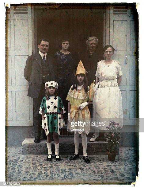 Family portrait of the Parisian bourgeoisie posing on the steps of his second home on the occasion of a family party The girls are disguised On the...