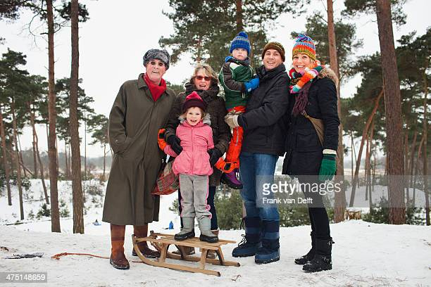 family portrait of three generations in winter scene - parka coat stock photos and pictures