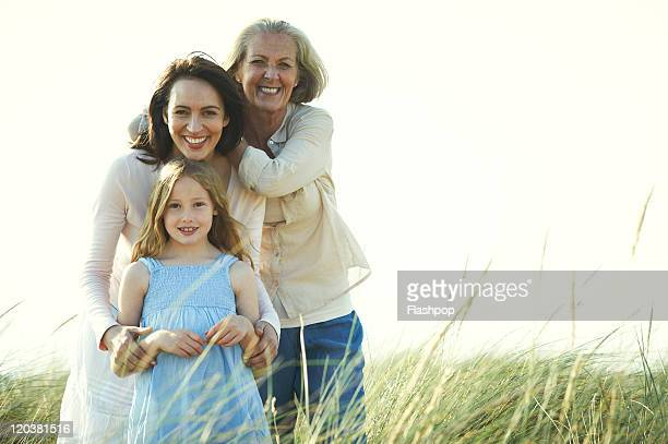 family portrait of three generations of women - generation gap stock pictures, royalty-free photos & images