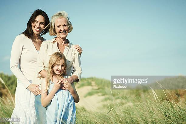 family portrait of three generations of women - baby boomer stock pictures, royalty-free photos & images
