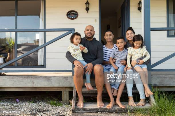 family portrait on house porch steps - medium group of people stock pictures, royalty-free photos & images