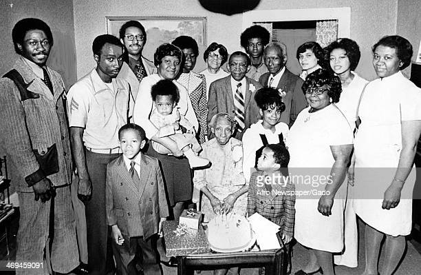 A family portrait showing descendants of Harriet Tubman including front row left to right Kevin Thomas the late Mrs Marie K Stewart Marshall C Booze...