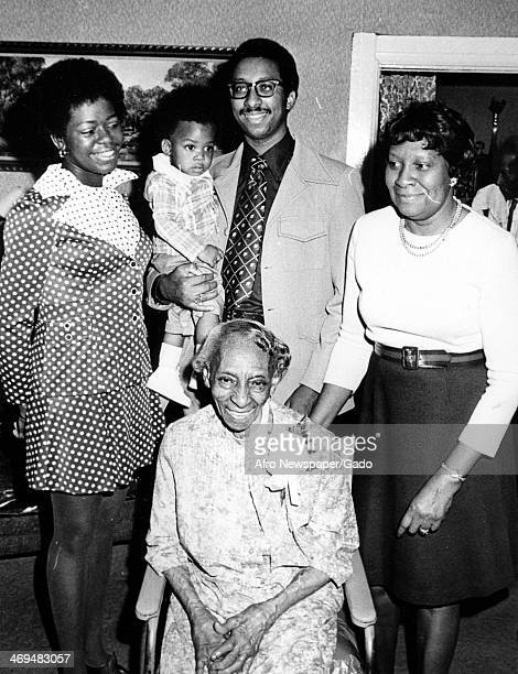 A family portrait showing Miss Anita Stewart with her grandson and his family Mrs Marie Stewart with her daughter on the right and Sergeant and Mrs...