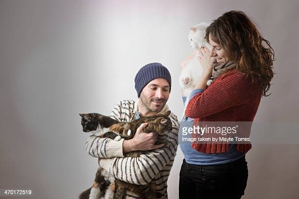 family portrait with cats and pregnant woman