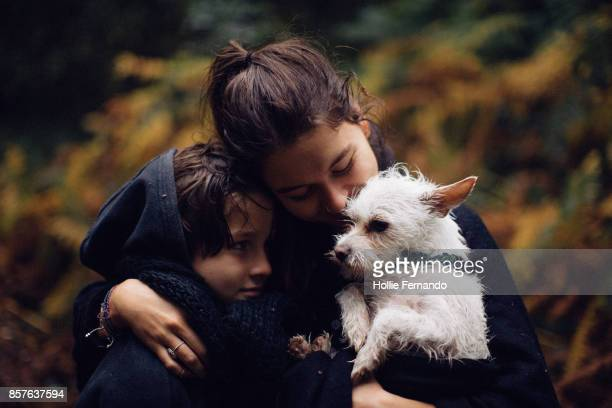 family portrait with dog - affectionate stock pictures, royalty-free photos & images