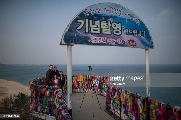 A family pose for a photograph on a viewing platform covered with ribbons bearing goodwill messages during a visit to Goseong Unification Observatory...