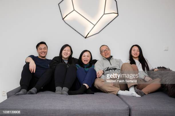 A Family Pose for a Relaxed Portrait in a Home in Oslo, Norway Wintertime